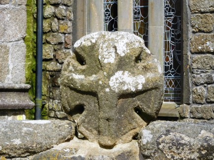 A Celtic cross with a human figure is the oldest part of the church in the village of Paul.