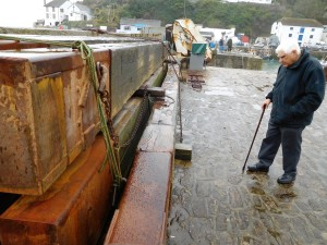 Terry checks out the timbers that keep the inner harbour safe from winter gales.