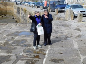 Marty and Ann look out to sea on the pier at  Porthleven.