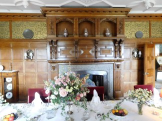 The dining room, the table laid for a royal visit.