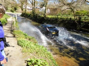 We crossed the ford on an old granite footbridge. The car driver smiled as she made a splash.