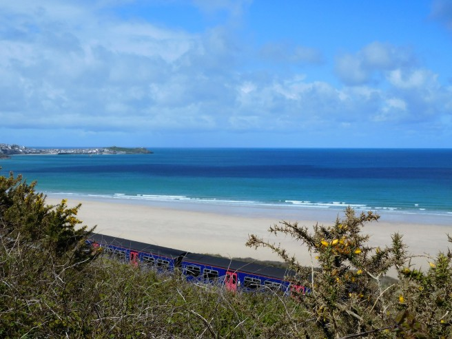 View toward St Ives in the distance from the Coast Path, the branch line train passing below us.