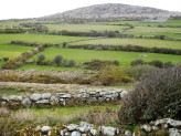 Granite hills and small fields with 3,000-year-old dry stone fences slope down to sea.