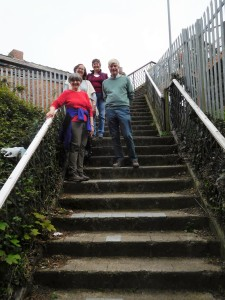 Marty, Jan, Lynne and Noel stand on the steps of the footbridge across the train tracks at Truro Station, the start of a walk outside the city.