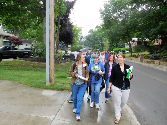 Shari Wagner, Indiana poet laureate, and Megan McClellan, executive trails director for Syracuse-Wawasee Trails, lead a group of more than 20 on a guided five-mile walk with stops for reading poetry that evoked past and present.