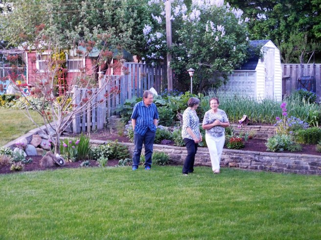 Dean Preheim-Bartel, Marty, and our sister-in-law Vivian, in a May visit, look over her garden at Viv and Brian's home in New Hamburg, Ontario. The garden and yard is an oasis for birds, butterflies, and a not-so-welcome rabbit.